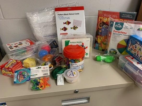 Photo avec des jouets pour Billet sur les achats du SIJE